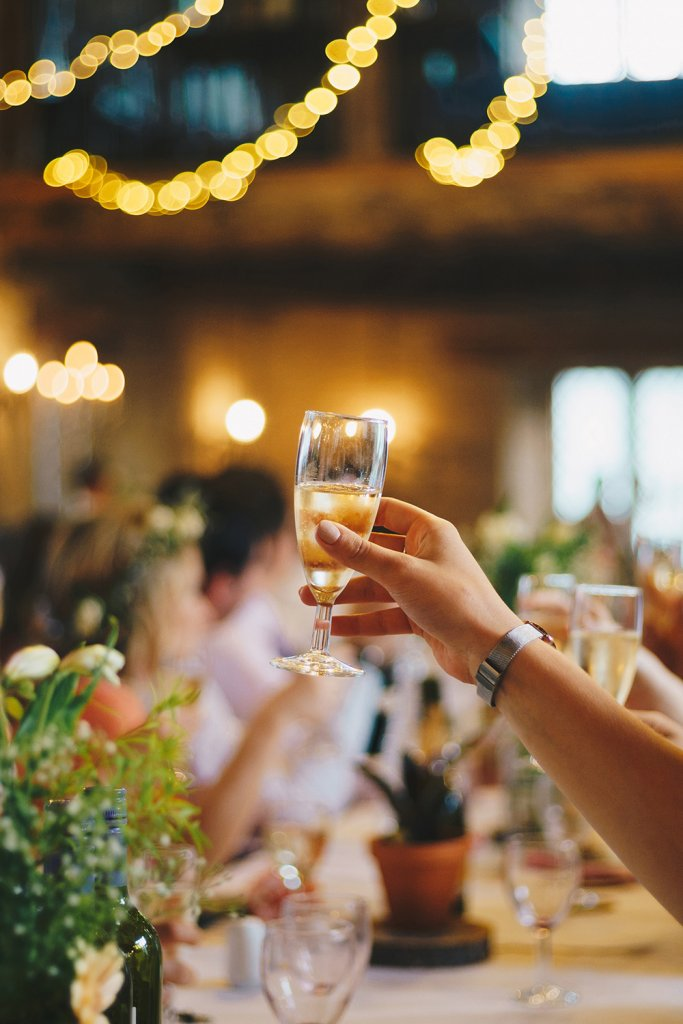 Hand holding a champagne glass - Share your joy with your loved ones & sendengagement party invitations, Elegant Events by Michalea, Palm Beach Wedding & Event Coordinator
