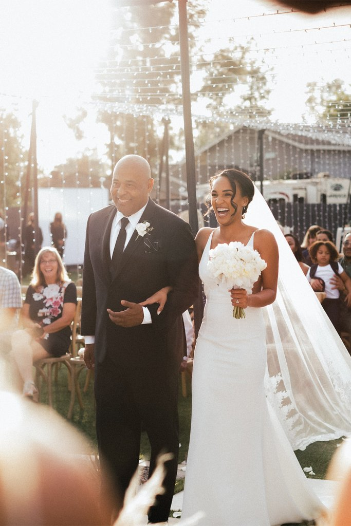 Man walking bride down the aisle - Have a family member officiate your small wedding ceremony