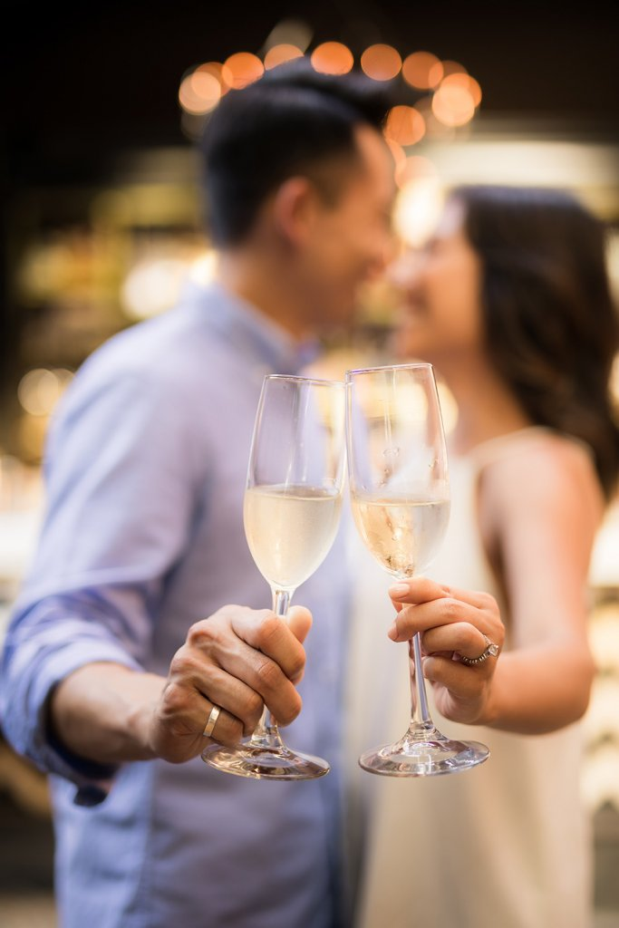 couple kissing with champagne glasses - Engagement Announcement on Elegant Events by Michalea, Palm Beach Wedding Coordinator