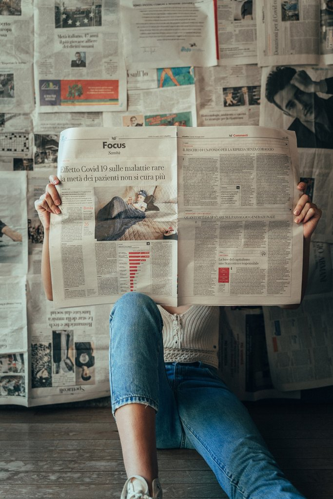 Person reading a newspaper - Announce your engagement in the newspaper Elegant Events by Michalea, Palm Beach Wedding Coordinator