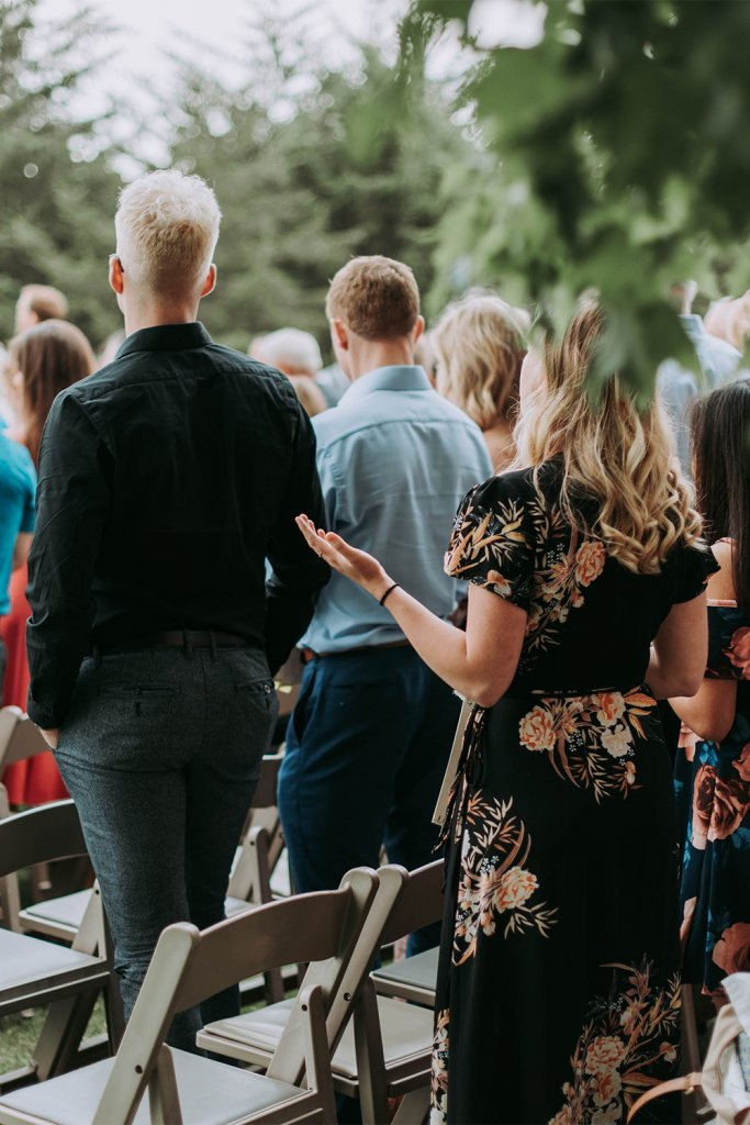 Wedding guests standing - Have a small wedding
